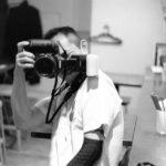 片腕のPhotographer